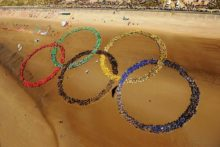 As London prepares to host the 2012 Games, the first Olympics world record has been set on Merseyside, by pupils forming the iconic rings.