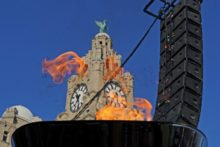The Olympic Torch made a colourful and emotional stop in Liverpool as it made its way to Merseyside en route to the Games in London.