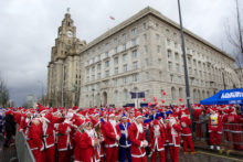 Thousands of red and blue Father Christmas runners ignored the bad weather to try to defend the Santa Dash title for Liverpool.