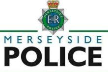 Merseyside Police are hunting two men who smashed the windows of a car while a terrified child was sat inside.