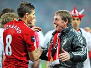 Steven Gerrard and Kenny Dalglish celebrate winning the League Cup in 2012. © Trinity Mirror