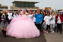 Around 1,000 people descended on Aintree racecourse to help raise funds and awareness for the Alzheimer's Society.