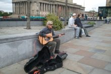 The city council has performed a U-turn by scrapping busking restrictions which entertainers said would drive them out of town.