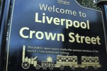 A park created on the site of the world's first passenger railway has been given new signs to mark its heritage.