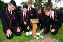 A Merseyside school has held a memorial service for a pupil who died after being swept out to sea.