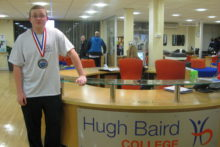 A 16-year-old junior strongman from Liverpool has won a silver medal in the World Powerlifting Championships.