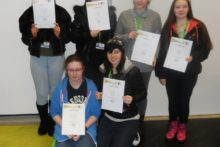 Students from Liverpool Community College have won first and second prize in an anti-bullying poster competition.