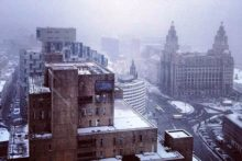 Liverpool has been hit by snow as temperatures dropped below freezing and brought local travel difficulties.