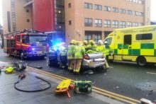 A woman had to be cut free from her car after a four-vehicle crash just outside LJMU's Redmonds Building.