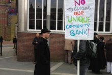 A local community has been out in force in an attempt to save what has been dubbed a 'unique' community bank.