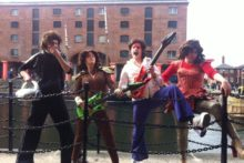Liverpool-based artists brought a touch of 70s glam to Albert Dock helping to celebrate the Tate Liverpool's new exhibition.