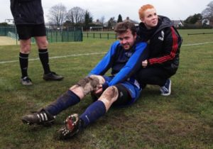 Bill Evans is comforted by Shannyn Quinn after suffering another cruciate ligament injury