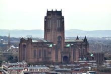 A Liverpool charity has taken to Twitter to recruit people to abseil down the Anglican Cathedral.
