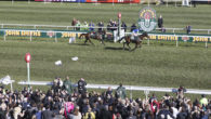 A 66-1 outsider, Auroras Encore, won the John Smith's Grand National in front of a bumper 70,000 Aintree crowd.