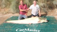 A Merseyside man holds the world record for catching the heaviest albino catfish after an epic struggle to land the beast.