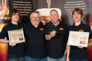 Left to right, Mark Powel, Harry Cobot, Steve Briscoe and Alex Morley celebrating the award. ©PeerlessBrewingCompany