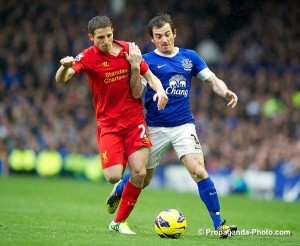 Liverpool's Joe Allen in action against Everton's Leighton Baines during the 219th Merseyside Derby match at Goodison Park last year. Pic © David Rawcliffe/Propaganda