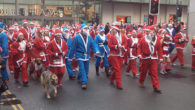 An estimated 10,000 people took to the streets of Liverpool dressed as Father Christmas for the city's 10th annual Santa Dash.