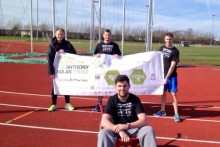 A group of friends who are taking on a wheelbarrow race for charity have beaten their fundraising target.