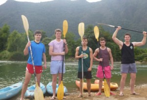 The rugged outdoors: Anthony, second left, and companions embark on a canoe adventure