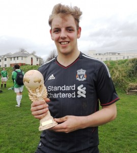 Josh Weale holds the JMU Journalism World Cup after scoring the only goal of the 2014 final
