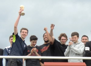 Captain Nick Seddon lifts the JMU Journalism World Cup aloft after Level 3 won the 2014 final. Pic by Roisin Brehony