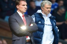Liverpool's hopes of ending their 24-year wait for a league title suffered a big blow after losing 2-0 to rivals Chelsea.