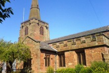 Campaigners in a Liverpool village have for now won their battle against their local church's extension plans in a graveyard.