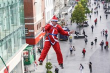 Father Christmas arrived earlier than expected this year as runners took to the skies on a Santa Dash landmark.