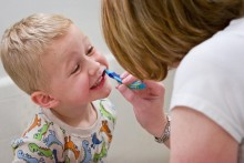 "A leading Liverpool academic accuses the government of a ""cop-out"" over children's dental hygiene guidelines."