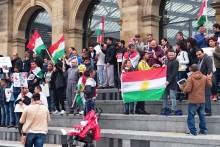 A demonstration in support of people trapped in ISIS-besieged Kobane was held at Lime Street Station.