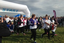 More than 2,000 people gathered at Aintree for a sponsored walk to raise money for people with Alzheimer's.