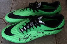 Wayne Rooney has donated a pair of his worn football boots to a specialist school for students with severe learning difficulties.
