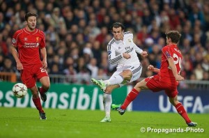Gareth Bale takes aim for Real Madrid against Liverpool at the Bernabeu Stadium. Pic © David Rawcliffe Propaganda Photo