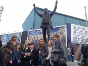 Thumbs up: Johnny King and his family infront of the new statue