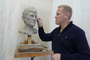 Steven at work on the Kenny Dalglish sculpture. Pic © Steven Hunter