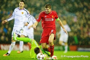 Steven Gerrard scored but could not prevent Liverpool going out of the Champions League against Basel. Pic © David Rawcliffe / Propaganda Photo