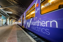 The first trains from Liverpool to Manchester on a newly electrified route are up and running.