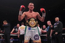 Derry Mathews capped off a memorable night for Liverpool's boxers by beating Tony Luis to the interim WBA world lightweight belt.