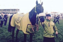Leighton Aspell triumphed with 25-1 underdog Many Clouds as he clinched back-to-back wins at Aintree.