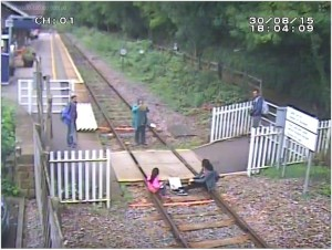 Matlock Bath - Children sit on rails while mother takes picture © Network Rail