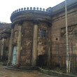 Two Liverpool universities are planning an £8m regeneration of the historic Wellington Rooms in the city centre.