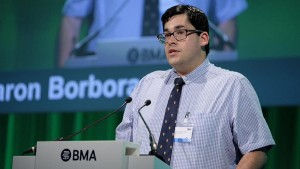 Doctor Aaron Borbora giving his speech at a British Medical Association meeting. © BMA