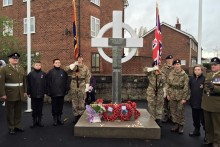A Remembrance Sunday service was held at a new cenotaph location in Moreton, despite fears it may not go ahead.
