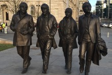 A new bronze statue of The Beatles has been unveiled on Liverpool's waterfront by John Lennon's sister, Julia Baird.