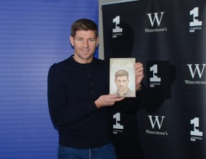 Steven Gerrard with his book at the signing event at LJMU. Pic by Sam Davies © JMU Journalism