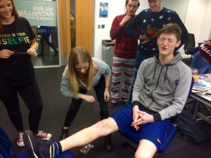 Leigh Kimmins endures a leg-waxing to raise money for Macmillan Cancer Support on JMU Journalism Christmas Jumpers Newsdays 2015