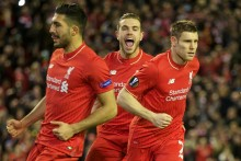 Liverpool warmed up for the Capital One Cup Final with a nervy but morale-boosting Europa League win over FC Augsburg.