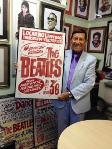 Tony Booth holding one of his Beatles posters. Pic © Tony Booth