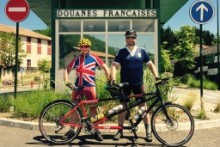 A Speke-born banker will cycle from one side of the country to boost a charity in Africa.